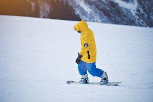 Snowboarding in mountains ski resort