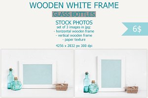 Wooden white frame with blue bottles