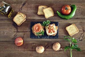 toast with tomato, oil, green olives