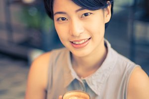 Asian woman drinking coffee
