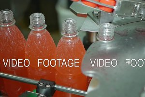 automatic screw cap on a bottle of soda mineral water, lemonade automatic conveyor line