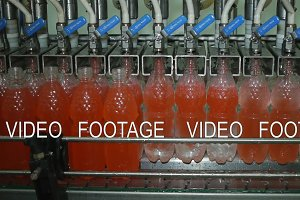Bottling of lemonade in plastic bottles. Lemonade bottle conveyor industry