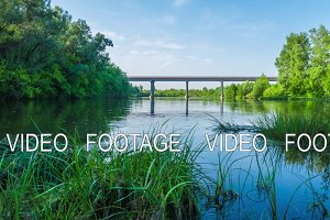 the river flows under the bridge a sunny summer day nature tour timelapse