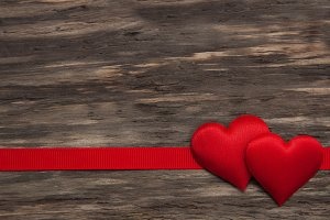 Fabric hearts and red ribbon