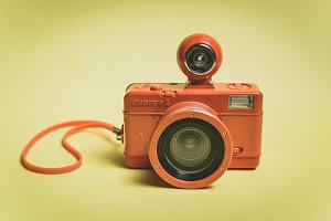 Old funny orange fisheye camera