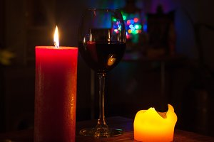 glass of wine with candles