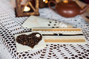 Card coffee beans white tablecloth