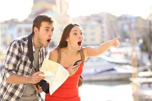 Amazed couple of tourists