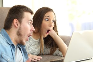 Amazed couple with open mouth