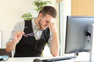 Businessman suffering eyestrain