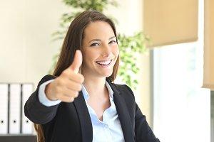 Happy businesswoman posing