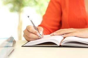 Businesswoman hand writing