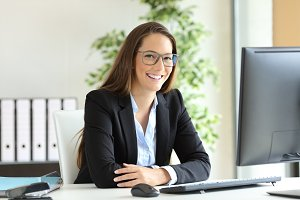 Happy businesswoman wearing suit