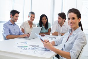 Attractive businesswoman smiling in business meeting