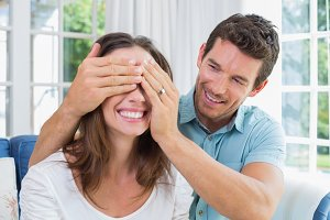 Close-up of a man surprising woman at home