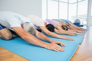 Fitness group in row at yoga class