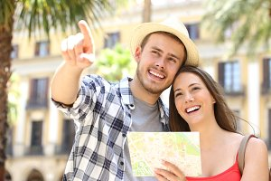 tourists consulting a guide map