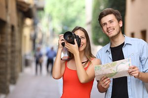 Joyful couple of tourists