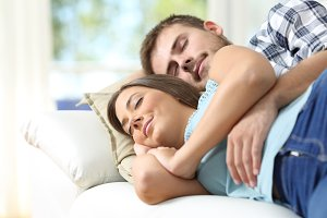 Couple hugging and sleeping