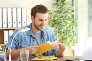 Entrepreneur opening an envelope