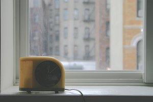 Vintage Clock in City Window