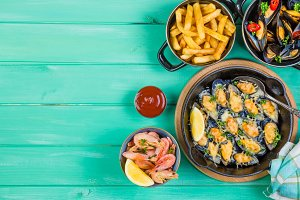 Selection of seafood meal on wood background