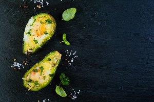 Baked avocado with eggs, top view