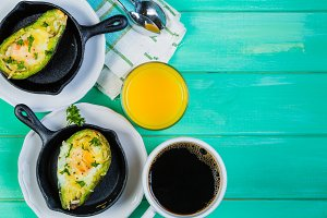 Breakfast - baked avocado with eggs, coffee and juice