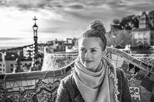 happy elegant tourist woman in Barcelona, Spain looking aside