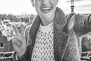 happy trendy tourist woman in Barcelona, Spain taking selfie