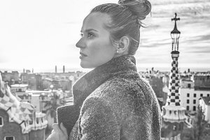 elegant tourist woman in Barcelona, Spain looking aside