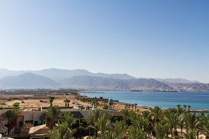 Panoramic view on Aqaba from central beach of Eilat .