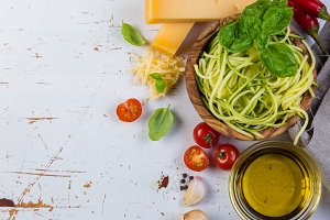Raw zucchini pasta and ingredients