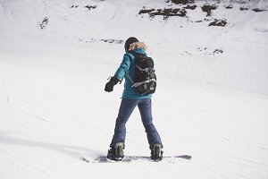 Woman snowboarder on the slopes.