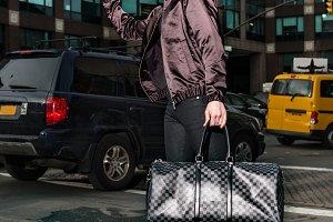 Fashionable tourist man with a bag