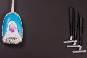 electric epilator with razor on a dark background