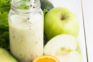 green smoothies in glass bottle