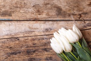Tulips in bunch lying on the wooden background