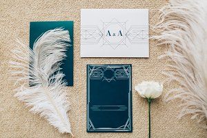 Blank stylized romantic invitation on carpet background. Top view