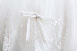 Beautiful white bow on wedding dress, closeup