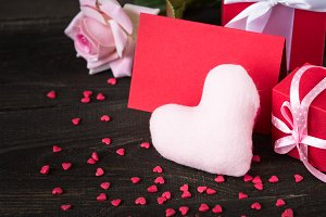 Valentine's Day background with  heart card rose gift.