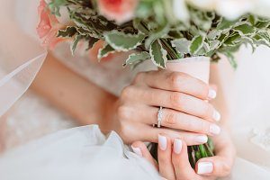 Wedding bouquet of flowers in brides' hands. Selective focus