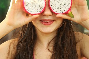 cut dragon fruit eyes teen girl