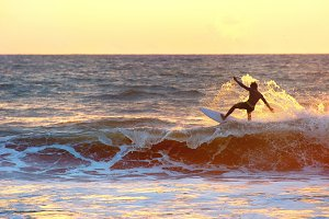 Surfer at sunset, silhouette