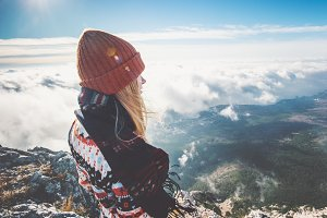 Woman on mountain enjoying view