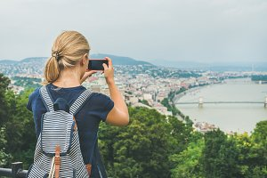 Woman making photoes of Danube river