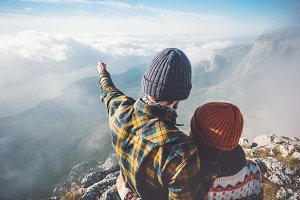 Couple enjoying mountains landscape