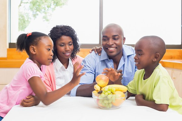 Happy family having fruit together