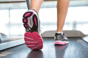 Womans feet running on the treadmill