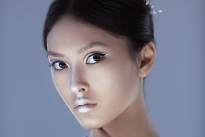 Shot of a futuristic young asian woman.